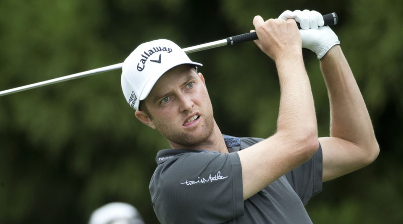 Chris Kirk hits from the second tee during the final round of the Tour Championship golf tournament Sunday, Sept. 14, 2014, in Atlanta. (AP Photo/John Bazemore)